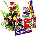 Send Graceful mixed lovely Roses clubbed with delicious assorted Cadburys Chocolates to Kerala