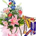 Send Charming seasonal Flowers with mouth-watering mixed Cadburys Chocolate to Kerala