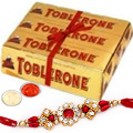 Send Delightful Toblerone with Free Nice Rakhi, Roli , Tilak and Chawal to Kerala